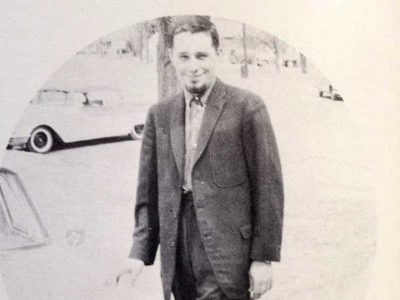 Harold Joe Waldrum and his light blue Peugot outside Lakin High School in the 1960s
