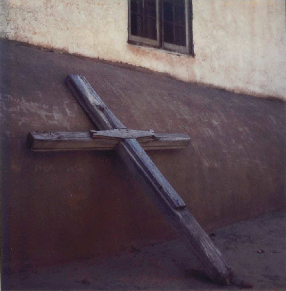 Cross leaning on a church - polaroid SX-70 by Harold Joe Waldrum